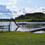 Lakefront with rafts and slides. Shallow water is perfect for swimming even with young kids.